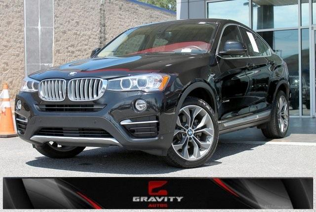 Used 2017 BMW X4 xDrive28i for sale $27,491 at Gravity Autos in Roswell GA 30076 1