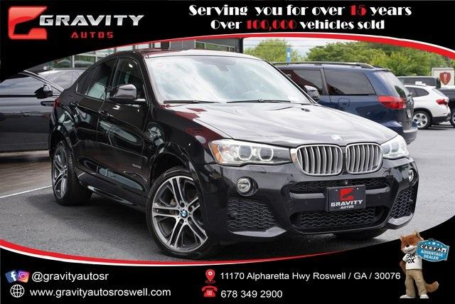 Used 2016 BMW X4 xDrive28i for sale $30,996 at Gravity Autos Roswell in Roswell GA 30076 1