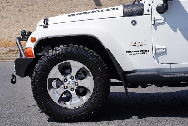 Used 2018 Jeep Wrangler JK Unlimited Sahara for sale $43,991 at Gravity Autos Roswell in Roswell GA 30076 11