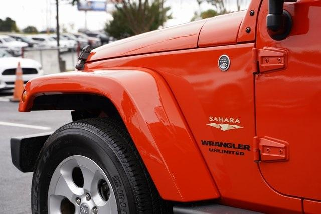 Used 2015 Jeep Wrangler Unlimited Sahara for sale $31,992 at Gravity Autos Roswell in Roswell GA 30076 11