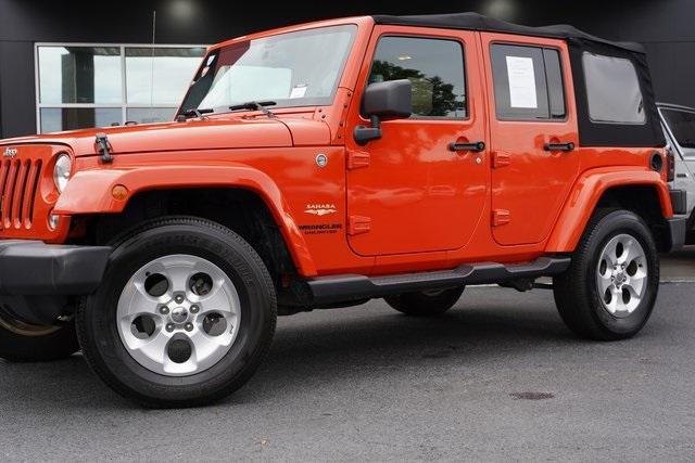 Used 2015 Jeep Wrangler Unlimited Sahara for sale $31,992 at Gravity Autos Roswell in Roswell GA 30076 3