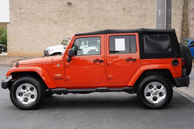 Used 2015 Jeep Wrangler Unlimited Sahara for sale $31,992 at Gravity Autos Roswell in Roswell GA 30076 4