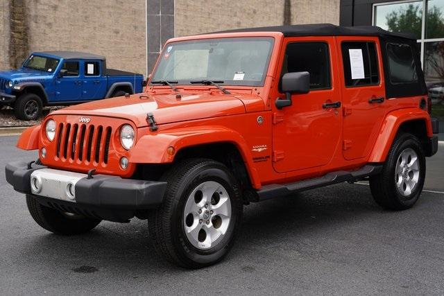 Used 2015 Jeep Wrangler Unlimited Sahara for sale $31,992 at Gravity Autos Roswell in Roswell GA 30076 5