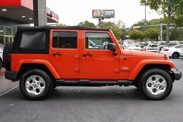 Used 2015 Jeep Wrangler Unlimited Sahara for sale $31,992 at Gravity Autos Roswell in Roswell GA 30076 8